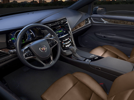 Other interior features includean auto-glide power-assisted covered storage/cup holder in the...