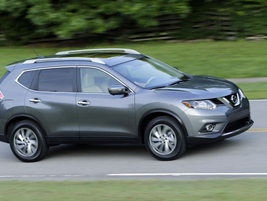On the outside, Nissan said the 2014-MY Rogue features standard halogen headlights with...