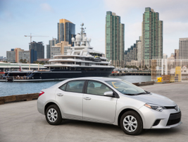 The 2014 Corolla L model. The L features standard Bluetooth connectivity, LED low-beam...