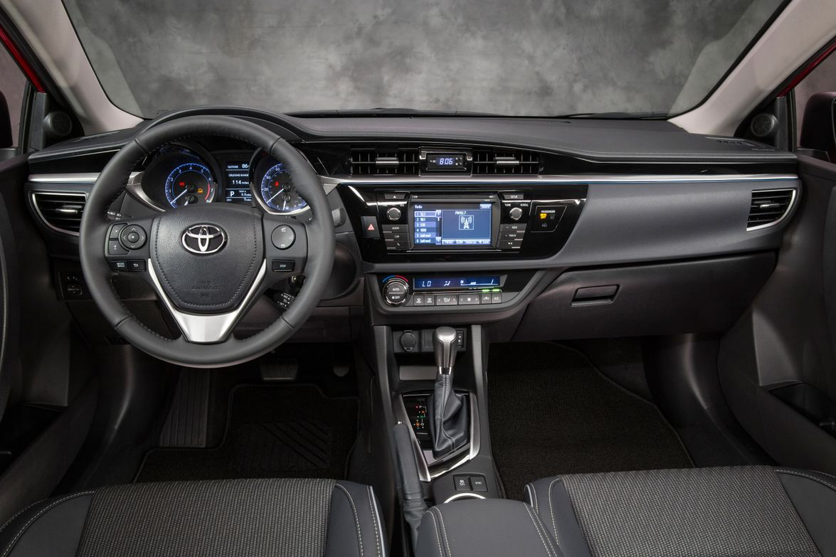 The dash and front seats in the Corolla S grade model. The S grade features a sport cluster with...