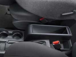 The center console includes a file folder bin for storage.