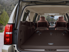 A power-folding feature is available for the fold-flat seats in the 2015 Tahoe and Suburban...