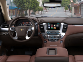 A conversation mirror in the overhead console provides a panoramic view of the back seats in the...