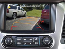 The rear vision camera when backing, displays the scene behind that may be unseen by the driver...