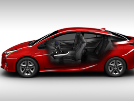 """For the 2016 Prius, Toyota has lowered the hood and rear spoiler, and incorporated a """"floating..."""