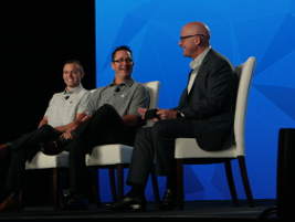 The Hershey Company's Thomas Smuda, VP of North American retail (middle), and Craig Stevenson,...