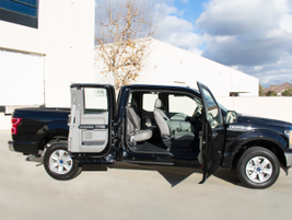 The SuperCab configuration includes a full front door and rear door on either side.
