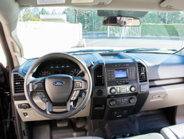 The cabin offers a USB charging port, an electronic parking brake located to the left of the...