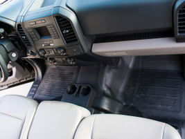 The truck lacks carpet, which allows fleet maintenance personnel to easily hose it off after...