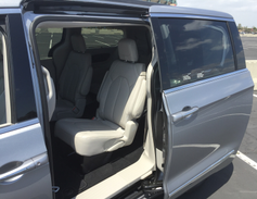 Power sliding side doors provide access to the passenger area.