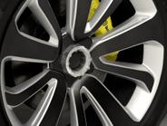 Yellow Brenbo brake calipers are visible behind center-locking hubs.