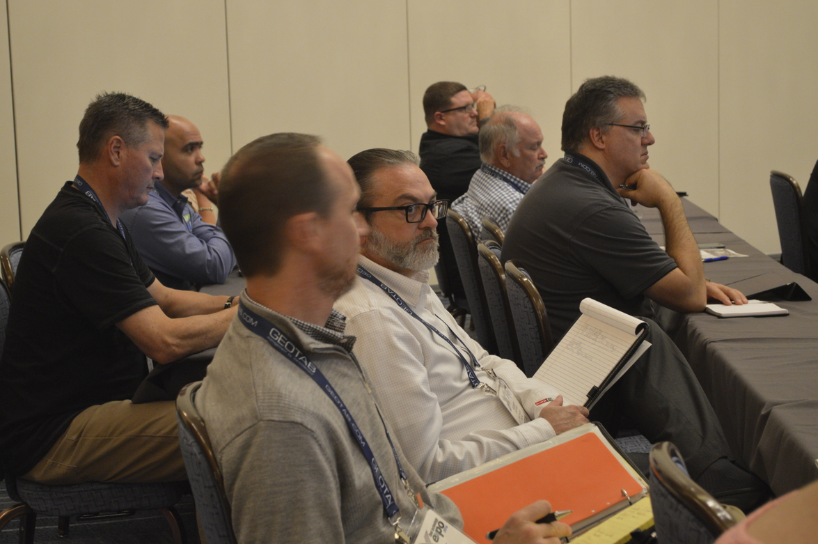 Attendees listen to a presentation at FTX.