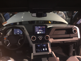 The truck's cabin offers several tech features, such as two display screens the size of small...