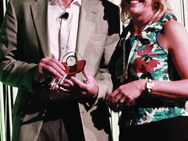 Tom Callahan (left), Donlen president and COO, accepted the President's Recognition Award from...