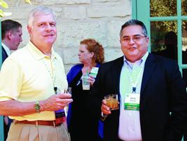 Rick Nicoletti (left), general manager for the Napleton Fleet Group, networks with Rick Ravelo,...