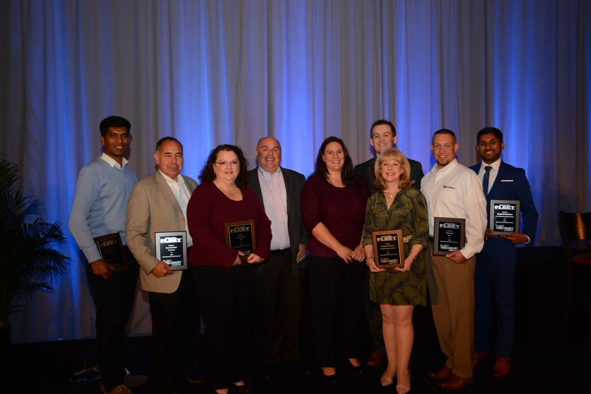 Several members of the Inaugural class of Fleet Visionaries pose with Dan Hannan and Tracy...