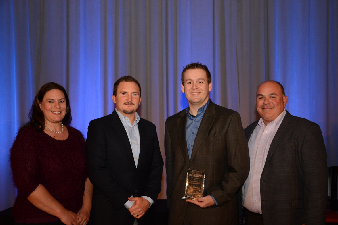 Jeff Moody of Centuri Construction Group (third from left) poses with Bobit Business Media...