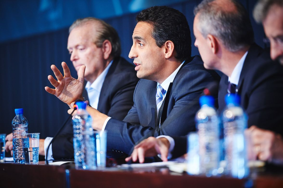 Maurice Benisty (center), chief commercial officer for GE Capital International, was part of a...