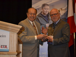 Dave Alfonso of KIA Motors (left) presented the IARA Circle of Excellence Award to Bob...