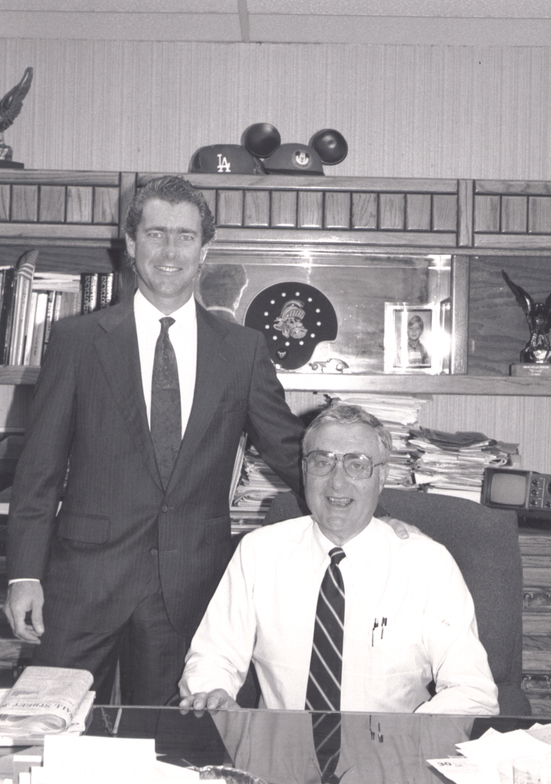 Ty and Ed Bobit at Ed's desk.