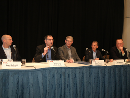 David Carp (second from left), director of fleet, remarketing & CPO, Kia Motors America, speaks...