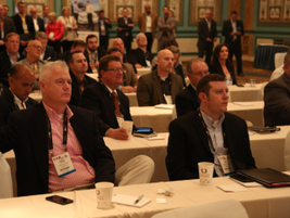 Attendees look on during a session at CAR 2017. Sessions included: disruptors in the automotive...