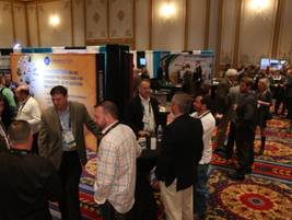 Attendees socialize at the CAR 2017 exhibit hall, which featured booths from partners and...
