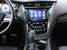 Snug cup holders can be covered when they're not in use. All controls are touch-based.