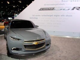 GM also brought its Code 130R sedan concept to the event. The vehicle seats four and is not...