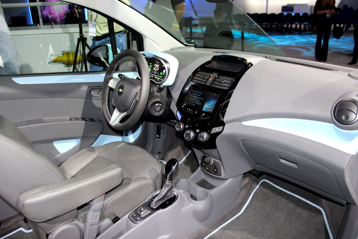 The Chevrolet Spark EV's cabin features noise-reduction and a combination of chrome and blue...