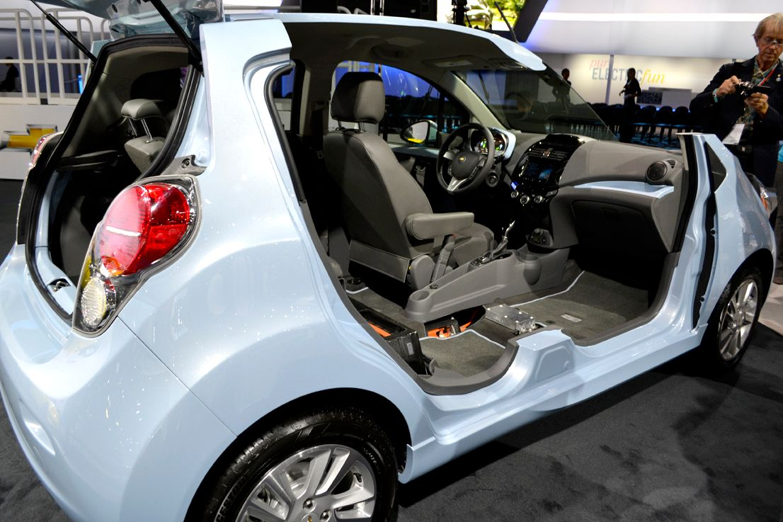 GM brought a cutaway of its Chevrolet Spark EV to the event. The Spark EV offers MyLink radio...