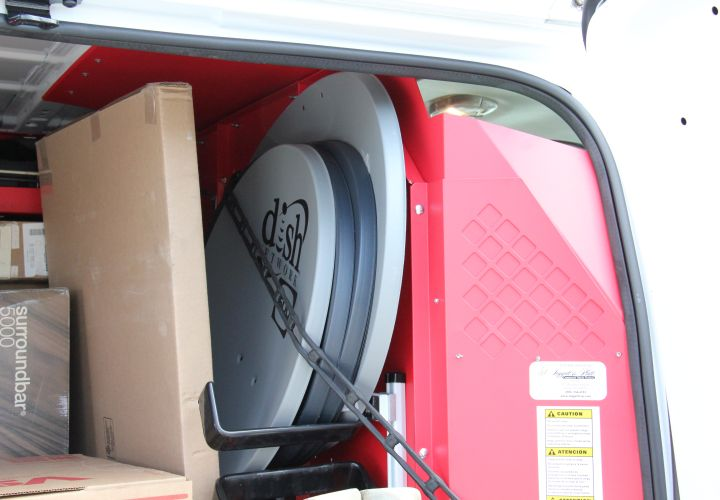 A special bracket secures the satellite dishes behind the passenger seat.