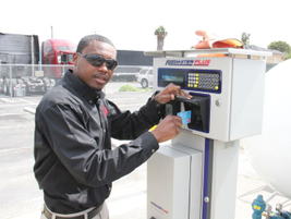 DISH technicians access the onsite fueling station by inserting their WEX fuel card into a fuel...