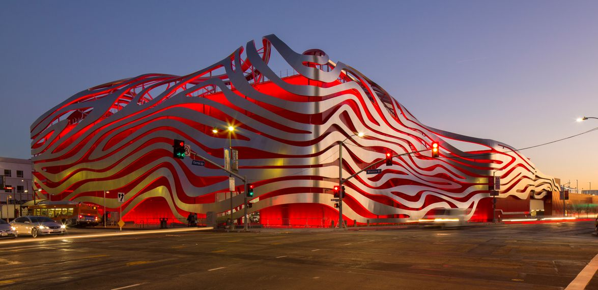 The museum can be back-lighted at night in various colors. Photo courtesy of Petersen Automotive...