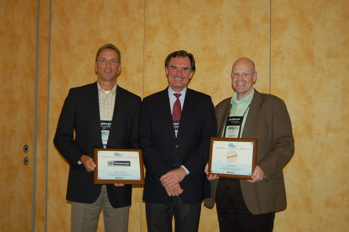 Mark Smith from the U.S. Department of Energy (center) announced two new Clean Cities...