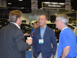 John Norris (middle), president, AmeriFleet, engages with NAFA attendees.