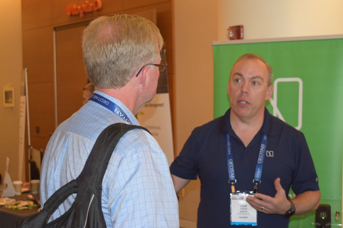 Dan Fedor, fleet sales manager for Nauto Inc., connects with a conference attendee at the Nauto...
