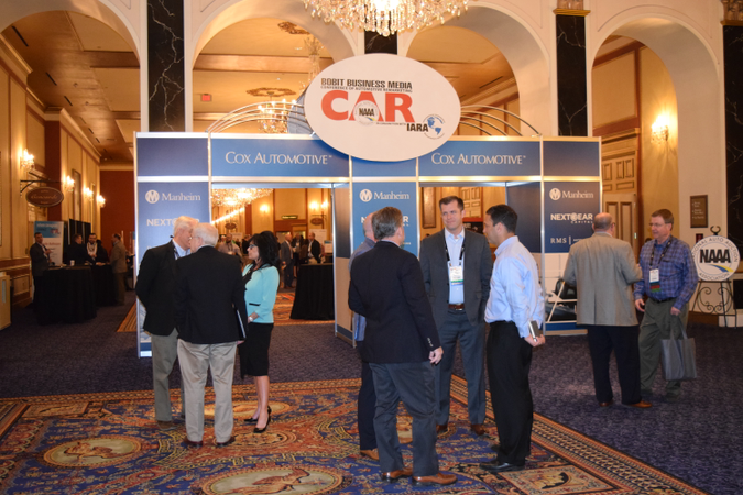 Attendees mingle at the entrance of the CAR 2017 exhibition hall at the Paris hotel in Las Vegas.