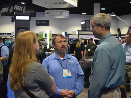 Bryan Flansburg (middle), CAFM, president, NAFA Fleet Management Association, speaks with...