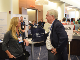 Lori Olson, fleet safety specialist for Pulse Protects, mingles with John Dmochowsky, senior...