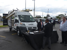 Fleet customers check out a Ram ProMaster van in the upfitter display area.