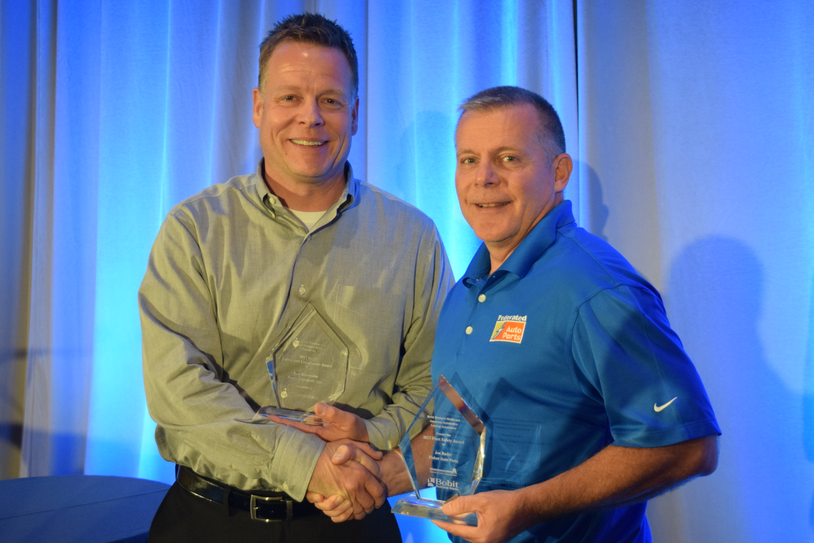 Ken Marvenko (left), director of safety and driver development, Paper Transport was awarded...