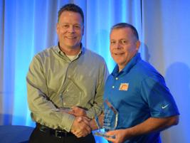 Ken Marvenko (left), director of safety and driver development, Paper Transport was awarded...