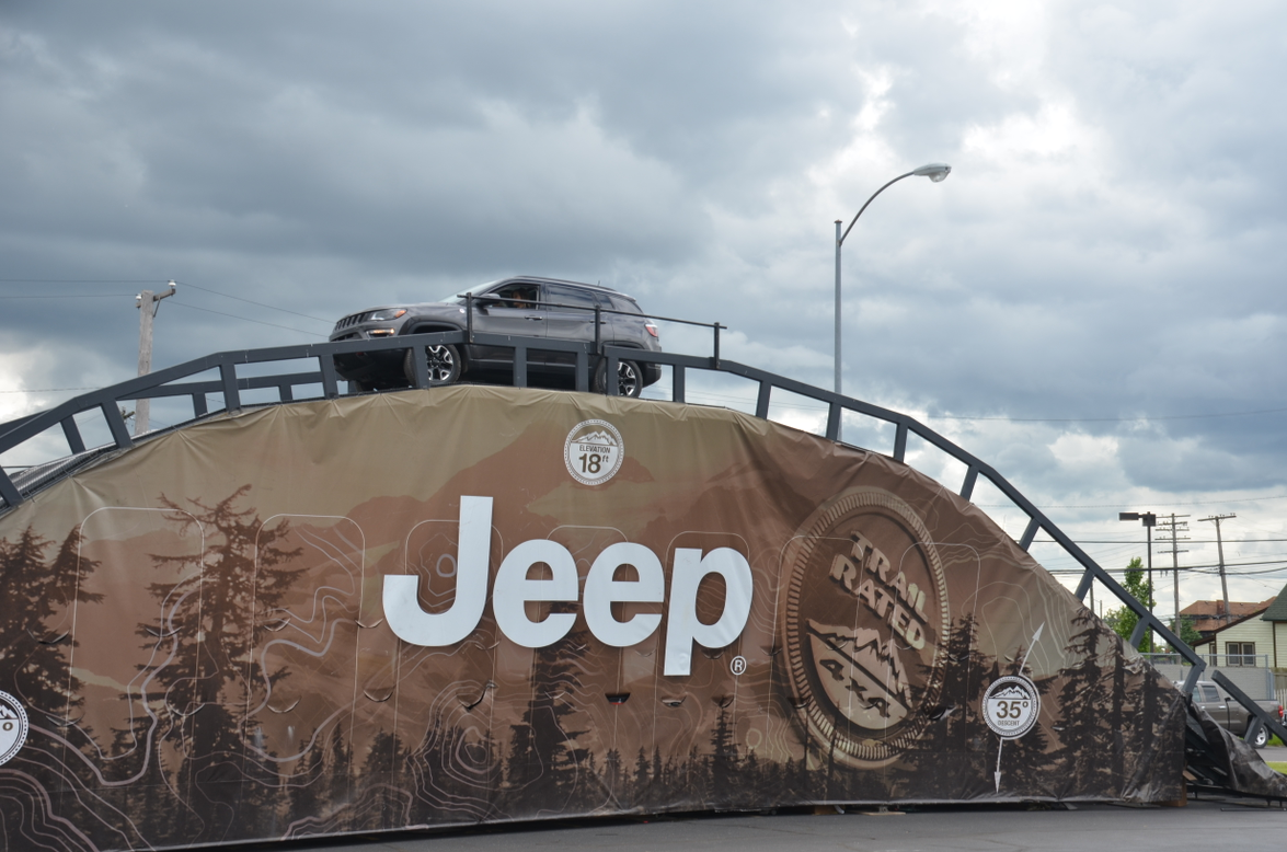 The new Jeep Compass crests the Jeep hill during the ride and drive portion of the national...