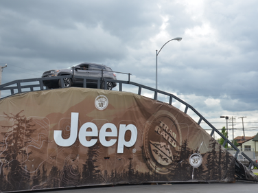 The newJeep Compass crests the Jeep hill during the ride and drive portion of the national...