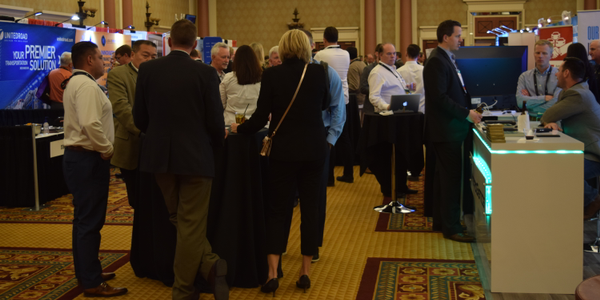 Attendees mingle in the exhibition showroom at CAR 2018 in Caesars Palace Las Vegas.