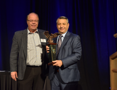 Tom Caruso (right), EVP for KAR Auction Services is honored with the Remarketer of the Year...
