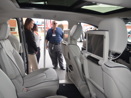Fleet customers check out the rear seating in the Chrysler Pacifica minivan.