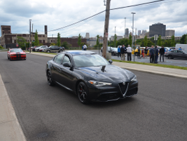 A fleet customer enjoys a drive around downtown Detroit in the Alfa Romeo Giulia.