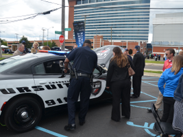 A police officer takes a closer look at the Dodge Charger Pursuit law enforcement vehicle.